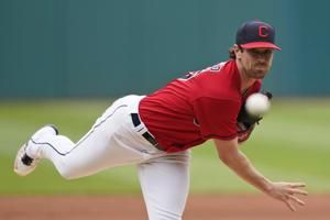 Indians ace Bieber says increased shoulder pain stopped him