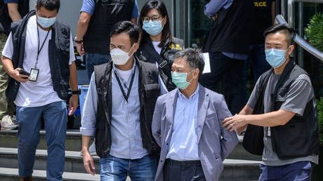 Hong Kong police charge 2 people with 'collusion with a foreign country' after arrests at Apple Daily newspaper