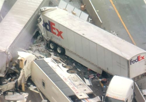 Suit claims trucker in Pa. Turnpike crash wore noise-canceling headphones