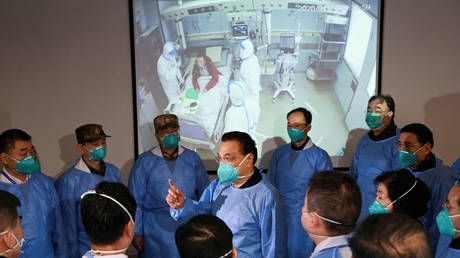 China's PM calls for 'resolute fight' against coronavirus outbreak as death toll climbs to 106 with nearly 1,300 new cases