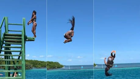 Making a splash: Gymnastics legend Simone Biles pulls off jaw-dropping dismount into the sea