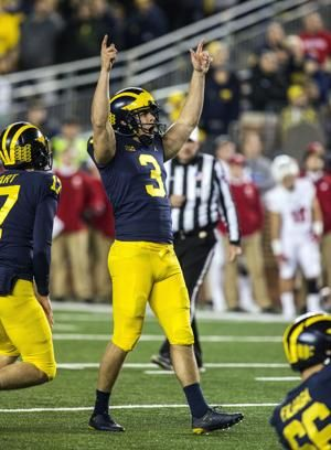 Patterson-led No. 12 Michigan routs No. 15 Wisconsin 38-13