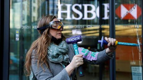 Extinction Rebellion activists break windows, stage protest outside HSBC HQ in London over fossil fuel financing