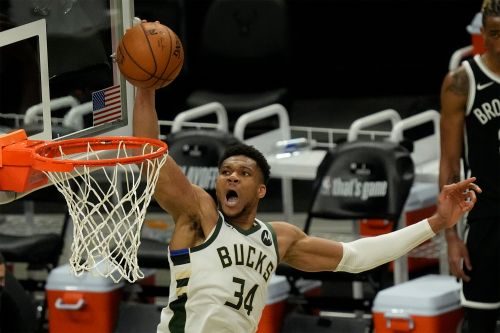 Dominant Giannis Antetokounmpo plays controversial role in Kyrie Irving injury