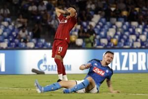 Napoli beats defending champion Liverpool 2-0 in CL