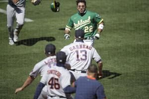 Laureano says Astros coach insulted mother, sparking fracas