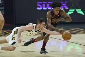 McConnell sets steals mark, Pacers rally past Cavs 114-111