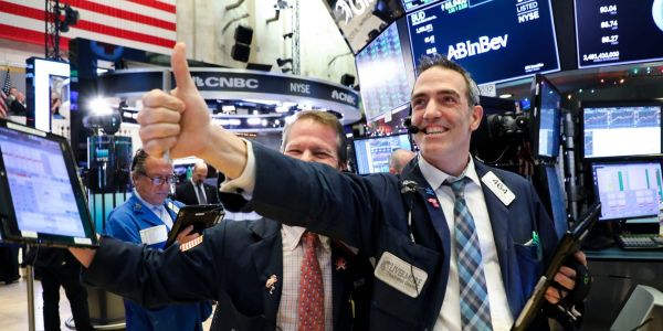 Dow, S&P 500 close at record highs after dismal jobs report gives Fed more breathing room
