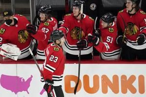 Alex DeBrincat scores twice, Malcolm Subban makes 39 saves and the Chicago Blackhawks beat the Tampa Bay Lightning 4-3 on Philipp Kurashev's shootout goal