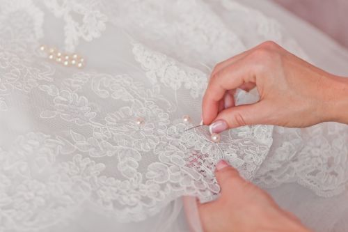 'She is an angel now': Woman creates infant burial gowns from wedding dresses
