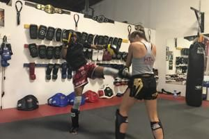 New Cal coach Charmin Smith learns from Muay Thai boxing