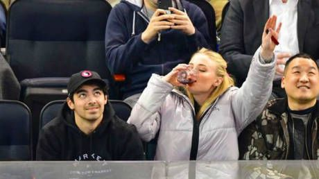 'Send it for the Starks': Game of Thrones star Sophie Turner downs glass of wine at NHL game