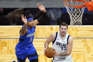 Mavs star Doncic sits out against Thunder with back issue