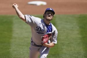 Dodgers' Roberts thinks Bauer being 'singled out' by umps
