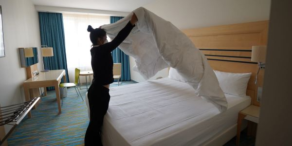 As travel picks up, hotels are looking for ways to cut labor costs by removing daily room cleanings
