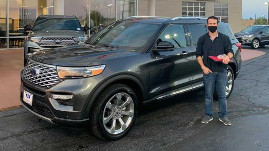 Man used stolen ID to purchase a $58K SUV, then posed for a photo at the dealership
