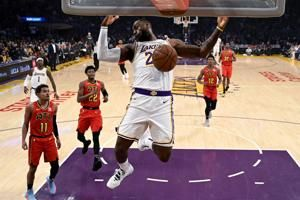 James, Lakers start fast in racing past Hawks 122-101