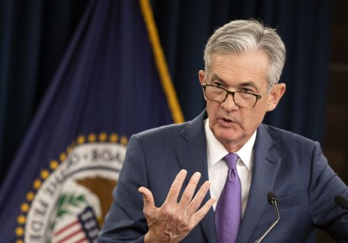 A divided Fed cuts key rate for 2nd time this year