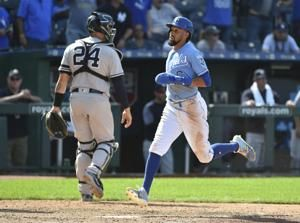 Merrifield singles in run in 10th, lifting Royals over Yanks