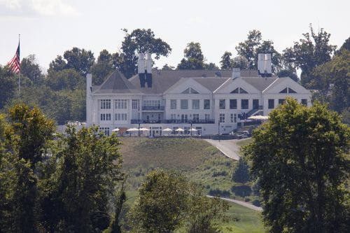 Man charged after exhaling on women outside Trump golf club