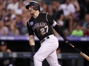 Gray settles down after rough start, Rockies beat Reds 5-4