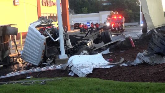Box truck catches fire after rolling over in parking lot off Route 1