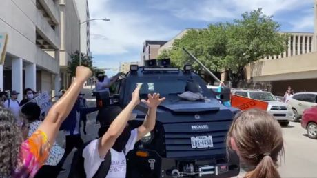 WATCH protesters attack InfoWars 'battle tank' at Black Lives Matter rally in Texas