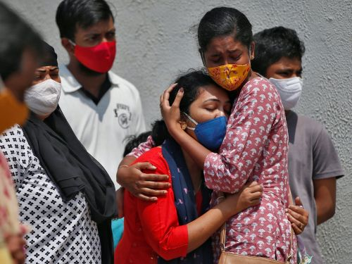 India's COVID-19 death toll reaches a grim milestone with a new record of more than 4,000 deaths reported on Saturday