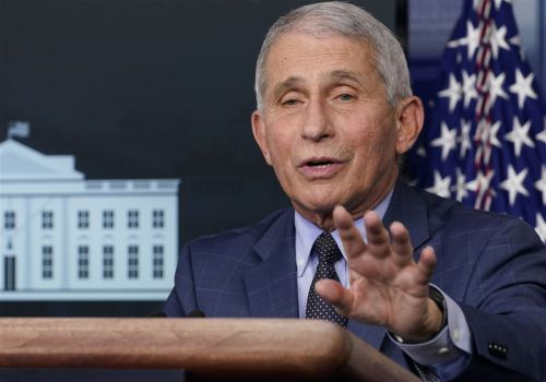 The Latest: Fauci apologizes for saying UK rushed vaccine