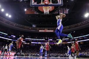 76ers overcome Joel Embiid's absence to beat Heat 106-102