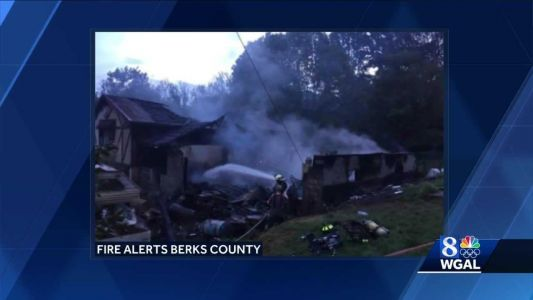 Elderly couple, 8 firefighters injured in house fire