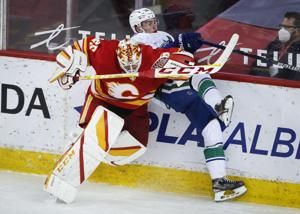 Flames, Canucks play out season amid playoff backdrop