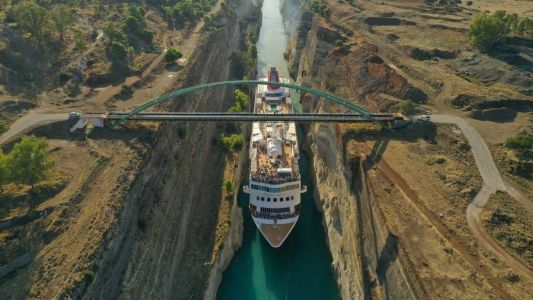 Video: Huge cruise ship squeezes through canal to claim record
