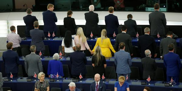 Brexit Party politicians turn their backs in protest against musicians playing the EU anthem