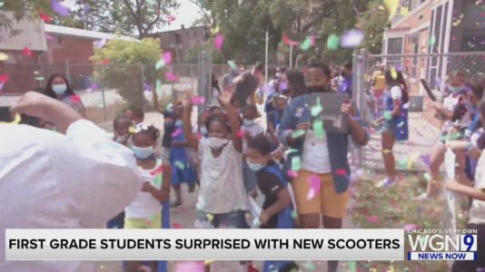 100 1st grade students surprised with new scooters