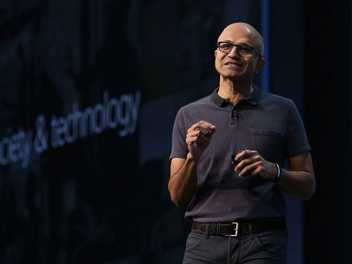 Microsoft adds new PowerPoint features that uses artificial intelligence to make you a better presenter - and keep you on-brand at all times