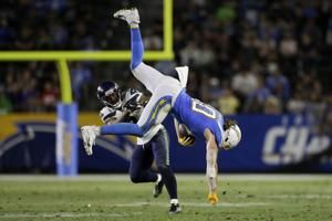 Wilson leads 2 TD drives as Seahawks defeat Chargers 23-15