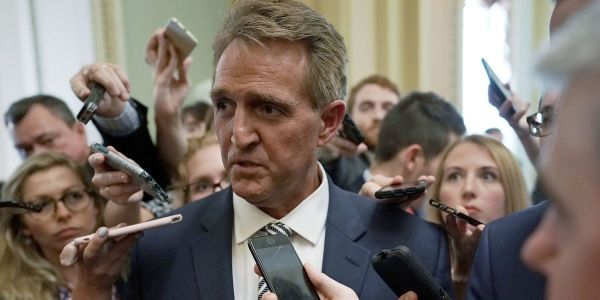 Jeff Flake threatens to block Trump's judicial nominees until Senate votes on bill to protect Mueller