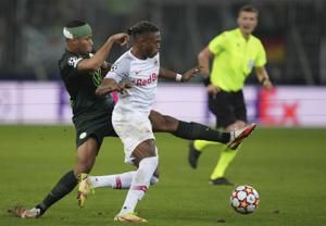 Salzburg beats Wolfsburg to extend group lead in CL