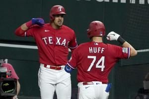 Rangers keep Astros waiting for playoffs with 5-4 win in 10
