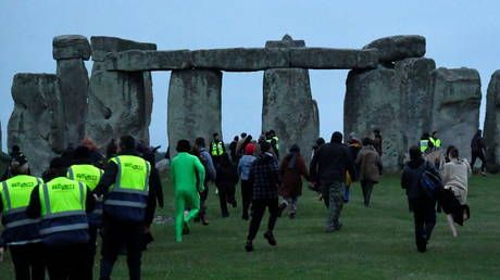 Police descend on Stonehenge's summer solstice event after crowd gathers at English monument in breach of Covid-19 rules