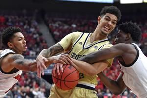 No. 6 Louisville rallies, then survives Georgia Tech 68-64