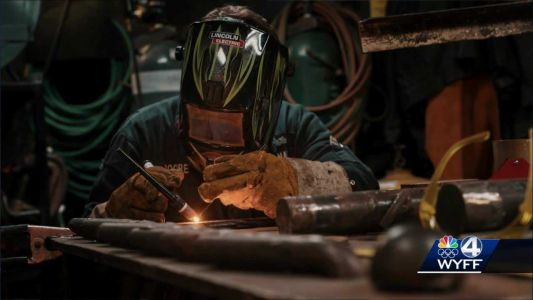 Upstate sailor using welding skills highlighted in Navy photo