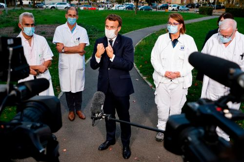 France's President Macron predicts nine more months of COVID-19 agony