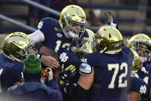 Book leads No. 2 Irish past Syracuse 45-21 in home finale