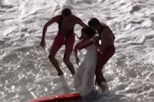 Couple nearly swept out to sea during wedding photoshoot