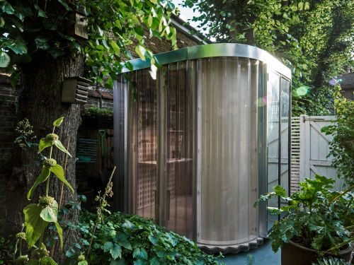 This $6,300 backyard tiny office made out of plywood and polycarbonate offers just 40 square feet to work from home in - see inside