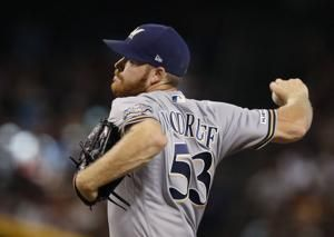 Brewers' Woodruff headed to injured list with oblique strain