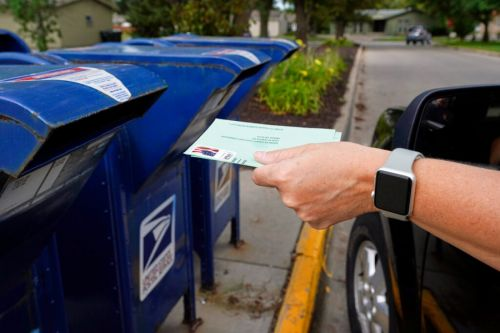 Postal delays persist around the country with mail voting underway