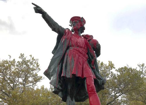 Columbus statue vandalized with red paint and words 'stop celebrating genocide'